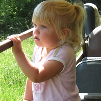 Granddaughter, Josilyn never gets tired of riding along on her Grandpa Kreycik's tour of his elk and buffalo.