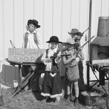 The kids dressed as Annie Oakley's siblings for our special tour in July.
